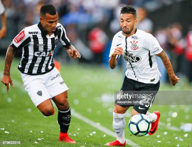 Romulo Otero of Atletico MG and Claysono of Corinthians in action during the match for the Brasileirao Series A 2017 at Arena Corinthians Stadium on...
