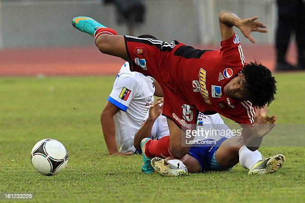 Romulo Otero of Caracas FC falls to the floor during a match between Caracas FC and Zulia FC as part of the Torneo Clausura 2013 at Olimpico Stadium...