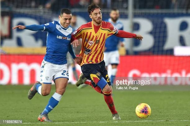 Romulo Souza of Brescia and Andrea Tabanelli of Lecce fight for the ball during the Serie A match between Brescia Calcio and US Lecce at Stadio Mario...