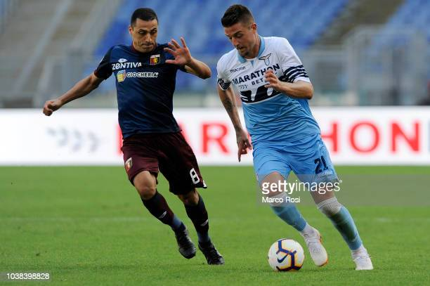 Romulo Souza of Genoa CFC compete for the ball with Sergej Milinkovic Savic of SS Lazio during the serie A match between SS Lazio and Genoa CFC at...
