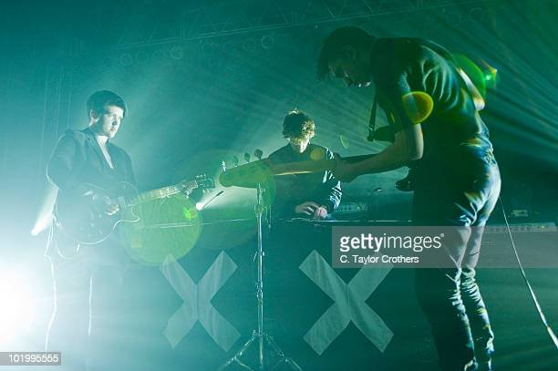 Romy Madley Croft, Jamie Smith and Oliver Sim of The xx perform onstage during Bonnaroo 2010 at That Tent on June 10, 2010 in Manchester, Tennessee.