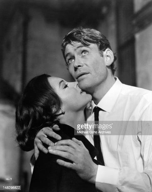 Romy Schneider nibbling on Peter O'Toole in a scene from the film 'What's New Pussycat' 1965