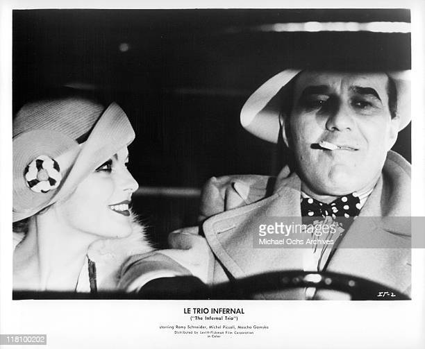 Romy Schneider sitting in car with Michel Piccoli in a scene from the film 'Le Trio Infernal' 1974