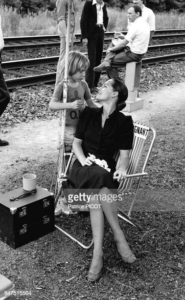 Romy Schneider with her son david on the set of 'Le train by Pierre Granier Deferre 1973