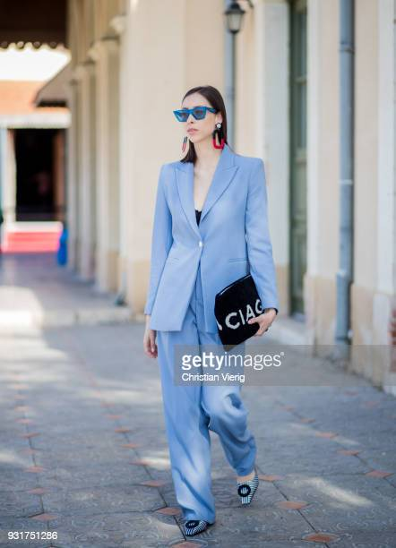 Romy Spector wearing blue Zara suit Celine sunglasses statement earrings Balenciaga clutch is seen during Tel Aviv Fashion Week on March 13 2018 in...