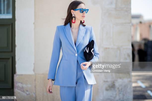Romy Spector wearing blue Zara suit Celine sunglasses statement earrings Balenciaga clutch is seen during Tel Aviv Fashion Week on March 13 2018 in...