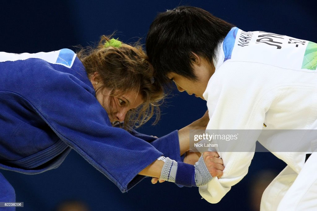 Romy Tarangul (L) of Germany competes against Misato Nakamura of Japan in their -52 kg women's preliminary judo event held during day 2 of the Beijing 2008 Olympic Games at the University of Science and Technology Beijing Gymnasium on August 10, 2008 in Beijing, China.