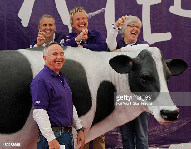 Ron Aebersold poses with his family daughters Kathy and Ashley and wife Jackie with the Chick fil A cow at Fan Fest before TCU plays the University...