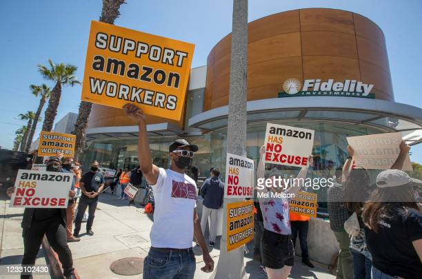 Ron Allen, foreground, left, a member of Art Directors Guild local 800, joins other supporters of Amazon workers protesting outside of Fidelity...
