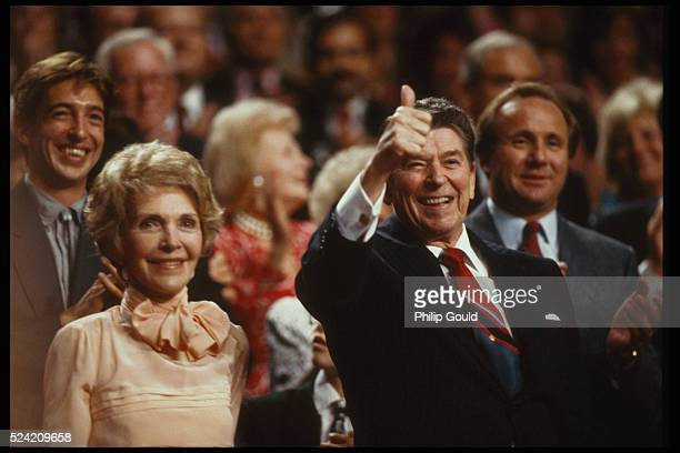 """Ron and Nancy Reagan stand in their box at the Republican National Convention. The President is giving the """"thumbs up """" sign."""
