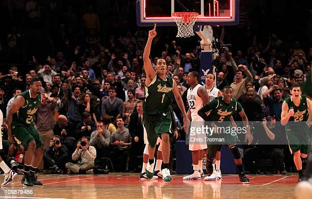 Ron Anderson Jr #1 Jawanza Poland and Shaun Noriega of the South Florida Bulls celebrate after defeathing the Villanova Wildcats during the first...