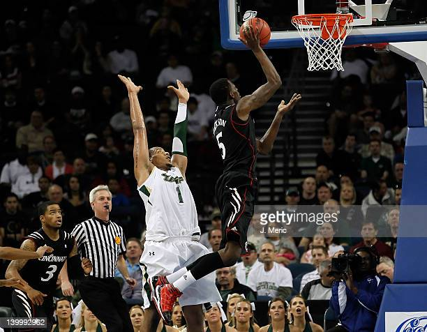 Ron Anderson Jr #1 of the South Florida Bulls defends Justin Jackson of the Cincinnati Bearcats during the game at the Tampa Bay Times Forum on...
