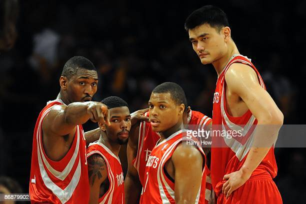 Ron Artest, Aaron Brooks, Kyle Lowry and Yao Ming of the Houston Rockets huddle against the Los Angeles Lakers in Game Two of the Western Conference...