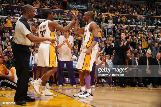 Ron Artest and Kobe Bryant of the Los Angeles Lakers bump hands during a game against the Denver Nuggets at Staples Center on February 28, 2010 in...