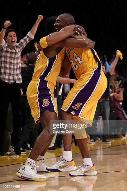 Ron Artest and Kobe Bryant of the Los Angeles Lakers celebrate Artest's game winning shot against the Phoenix Suns in the fourth quarter of Game Five...