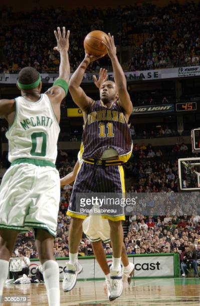 Ron Artest of the Boston Celtics against Jamaal Tinsley of the Indiana Pacers March 12, 2004 at the Fleet Center in Boston, Massachusetts. NOTE TO...