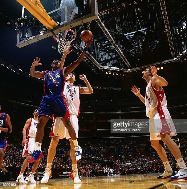 Ron Artest of the Eastern Conference AllStars shoots against Yao Ming of the Western Conference AllStars during the 2004 AllStar Game on February 15...