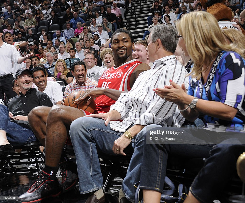 Ron Artest #96 of the Houston Rockets tries to save a ball and ends up in a fan's seat during the game against the San Antonio Spurs on March 22, 2009 at the AT&T Center in San Antonio, Texas.