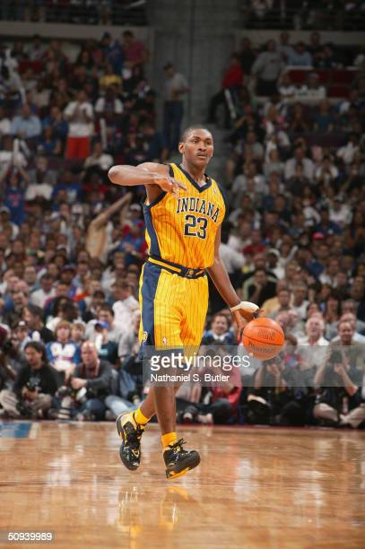 Ron Artest of the Indiana Pacers advances the ball through center court against the Detroit Pistons in game six of the Eastern Conference Finals...