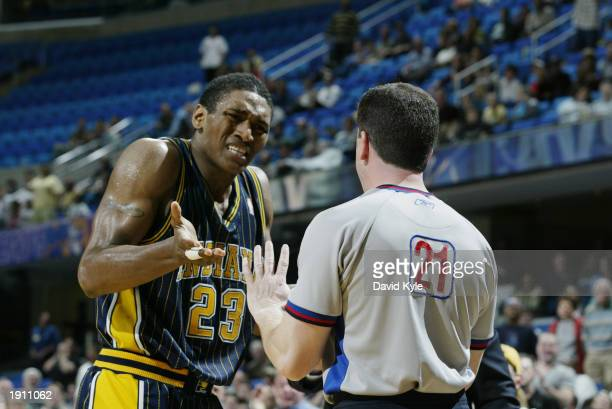Ron Artest of the Indiana Pacers argues a call with referee Tim Donaghy during the game against the Cleveland Cavaliers at Gund Arena on April 2 2003...