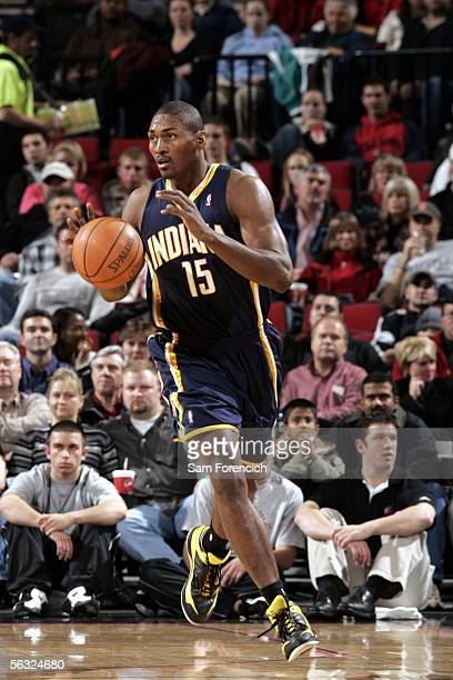 Ron Artest of the Indiana Pacers dribbles the ball during a game against the Portland Trail Blazers on December 2 2005 at the Rose Garden Arena in...