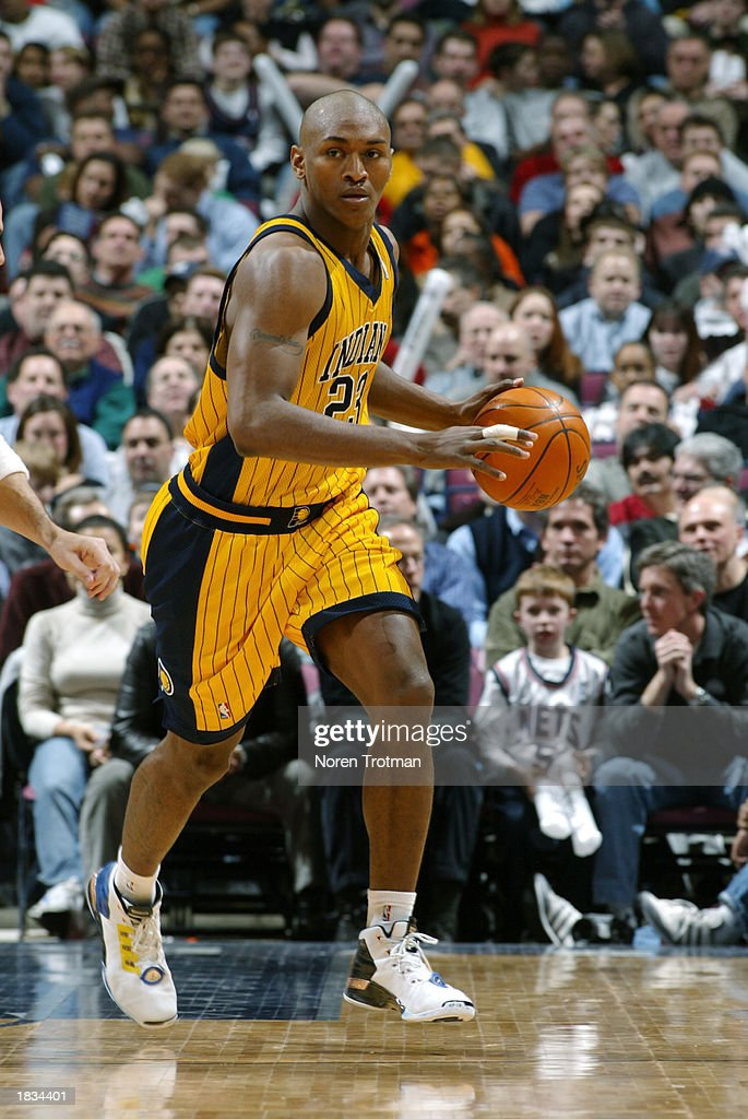 promo code 1a709 b5ec8 Ron Artest of the Indiana Pacers drives against the New ...