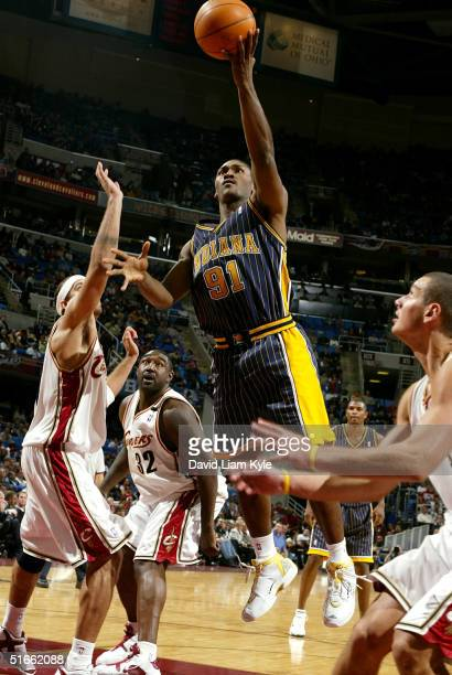Ron Artest of the Indiana Pacers drives in for a layup against the Cleveland Cavaliers on November 3 2004 at Gund Arena in Cleveland Ohio NOTE TO...