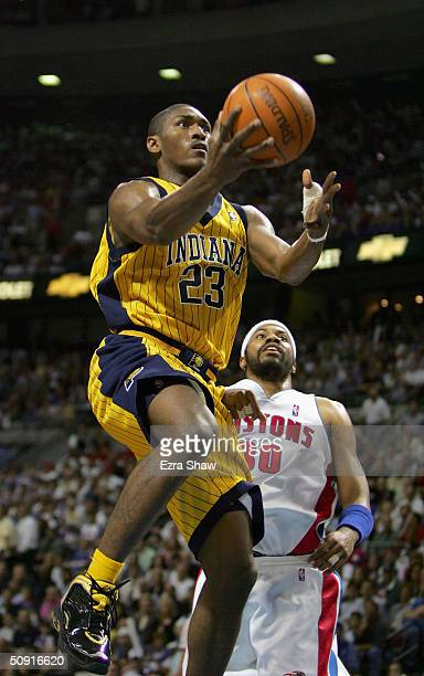 Ron Artest of the Indiana Pacers goes to the basket past Rasheed Wallace of the Detroit Pistons in Game six of the Eastern Conference Finals during...