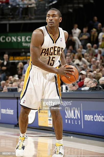 Ron Artest of the Indiana Pacers looks to move the ball during the game against the Dallas Mavericks at Conseco Fieldhouse on December 6 2005 in...