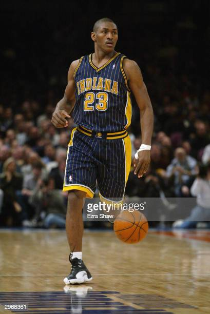 Ron Artest of the Indiana Pacers moves the ball up court during the game against the New York Knicks at Madison Square Garden on February 3, 2004 in...