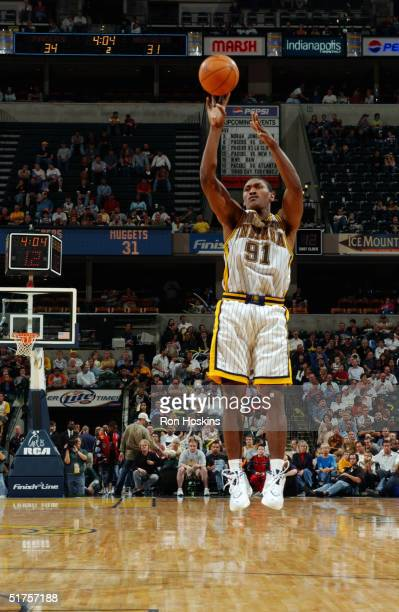 Ron Artest of the Indiana Pacers shoots against the Denver Nuggets during a preseason game at Conseco Fieldhouse on October 29, 2004 in Indianapolis,...
