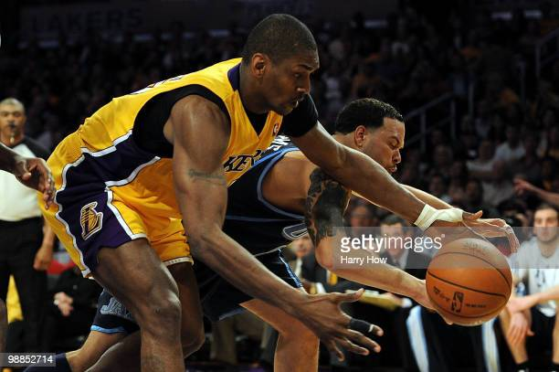 Ron Artest of the Los Angeles Lakers and Deron Williams of the Utah Jazz battle for a loose ball during Game Two of the Western Conference Semifinals...