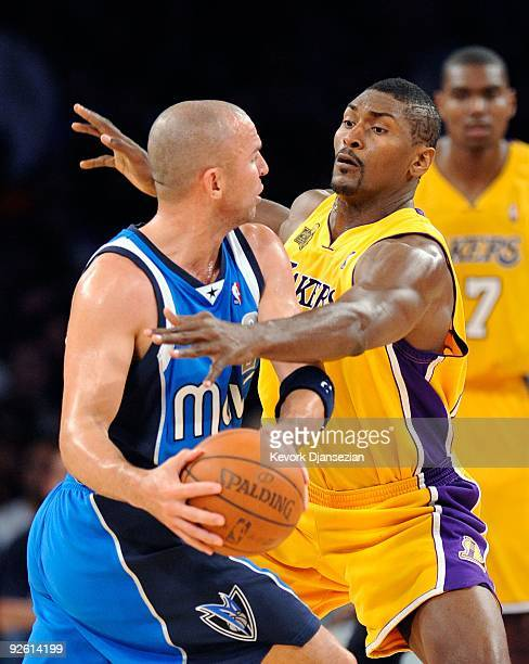Ron Artest of the Los Angeles Lakers defends against jason Kidd of the Dallas Mavericks during the second quarter of the NBA basketball game at...
