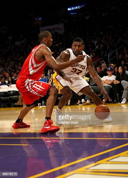 Ron Artest of the Los Angeles Lakers drives against Trevor Ariza of the Houston Rockets on November 15 2009 at Staples Center in Los Angeles...