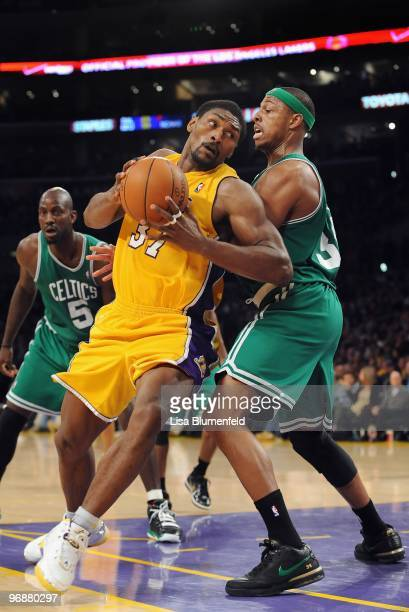 Ron Artest of the Los Angeles Lakers drives to the basket against Paul Pierce of the Boston Celtics at Staples Center on February 18, 2010 in Los...