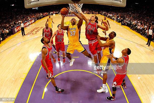 Ron Artest of the Los Angeles Lakers goes to the basket against Joakim Noah of the Chicago Bulls during the game on November 19, 2009 at Staples...