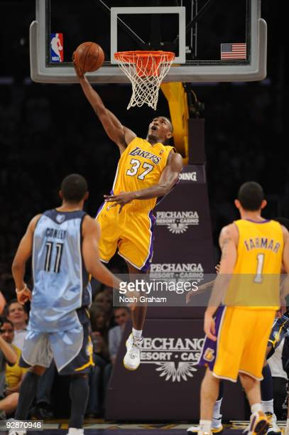 Ron Artest of the Los Angeles Lakers goes up for a shot against the Memphis Grizzlies at Staples Center on November 6 2009 in Los Angeles California...