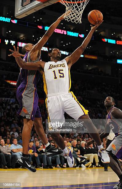 Ron Artest of the Los Angeles Lakers lays a shot up against Grant Hill of the Phoenix Suns at Staples Center on November 14, 2010 in Los Angeles,...
