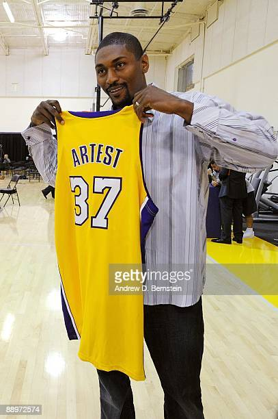 Ron Artest of the Los Angeles Lakers poses with his jersey after the press conference announcing his signing with the team on July 8 2009 at the...
