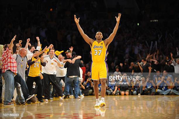 Ron Artest of the Los Angeles Lakers raises his arms after making a shot against the Boston Celtics in Game Seven of the 2010 NBA Finals on June 17,...