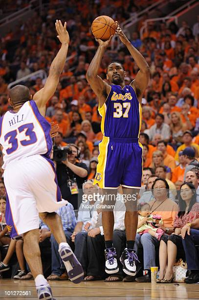 Ron Artest of the Los Angeles Lakers shoots against Grant Hill of the Phoenix Suns in Game Six of the Western Conference Finals during the 2010 NBA...