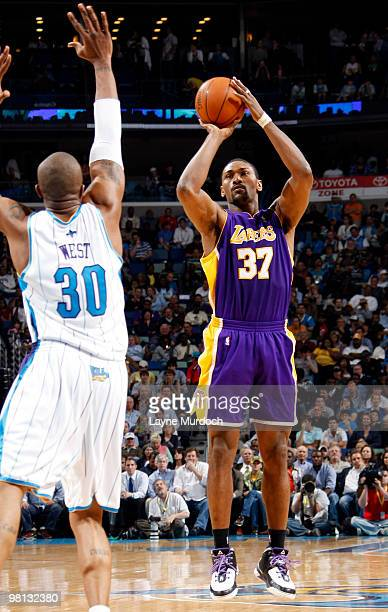 Ron Artest of the Los Angeles Lakers shoots over David West of the New Orleans Hornets on March 29 2010 at the New Orleans Arena in New Orleans...
