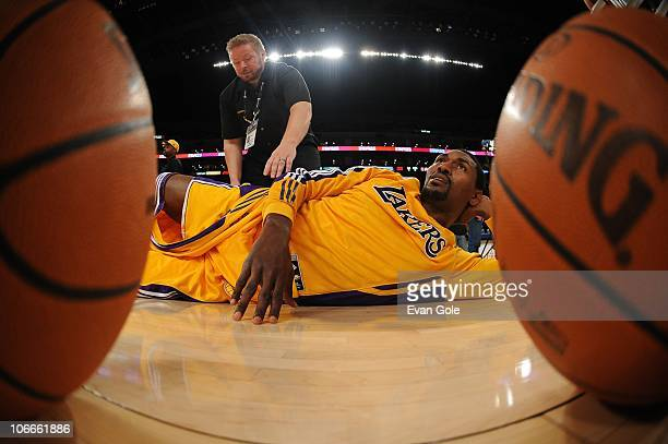 Ron Artest of the Los Angeles Lakers stretches before taking on the Minnesota Timberwolves at Staples Center on November 9 2010 in Los Angeles...