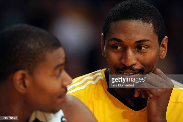 Ron Artest of the Los Angeles Lakers talks with teammate Andrew Bynum during a preseason game against the Charlotte Bobcats at Staples Center on...