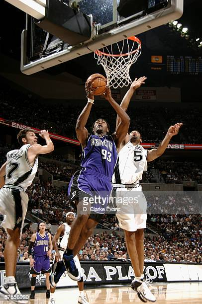 Ron Artest of the Sacramento Kings shoots against Robert Horry and Brent Barry of the San Antonio Spurs in game five of the Western Conference...