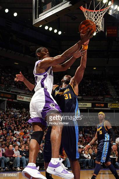 Ron Artest of the Sacramento Kings takes the ball to the basket against Nene of the Denver Nuggets on February 3 2007 at ARCO Arena in Sacramento...