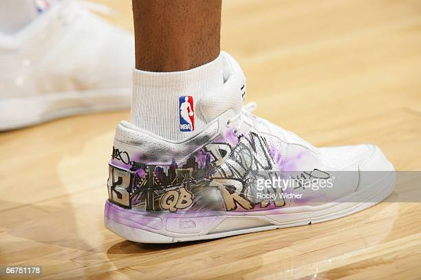 Ron Artest of the Sacramento Kings wears his new shoes before his team takes on the Utah Jazz on February 5 2006 at the ARCO Arena in Sacramento...