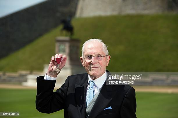 Ron Ayers chief of aerodynamics with the Bloodhound supersonic car project with his MBE for services to engineering presented to him by Queen...