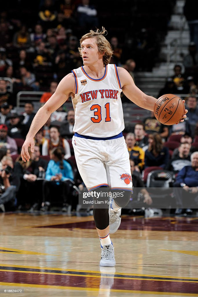Ron Baker #31 of the New York Knicks dribbles the ball against the Cleveland Cavaliers on October 25, 2016 at Quicken Loans Arena in Cleveland, Ohio.