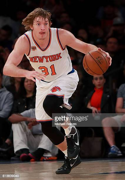 Ron Baker of the New York Knicks dribbles with the ball against the Washington Wizards in the second half of the preseason game at Madison Square...